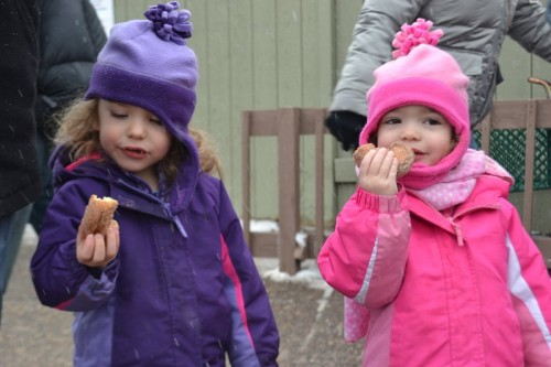 The girls enjoying their apple cider donuts